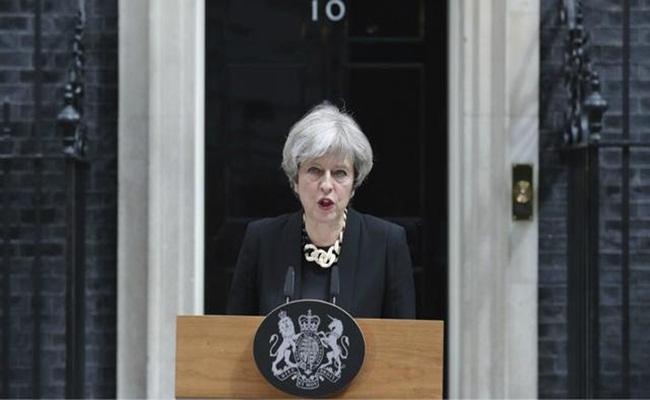 PM Inggris Theresa May Foto Andrew Matthews PA via AFP - PM Inggris Berniat Merevisi Aturan Tentang HAM Untuk Mengatasi Terorisme